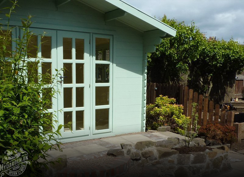 Teal colour garden shed with glass pane windows